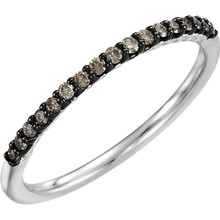 A beautiful 14k white gold 1/6 ctw brown diamond stackable ring.