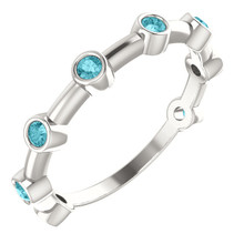 Crafted in sterling silver, this ring features 8, round, blue zircon gemstones.