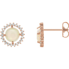 Exquisite 14Kt rose gold earrings capturing the beauty of a round radiant genuine opal in each surrounded by white shimmering diamonds.