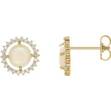Exquisite 14Kt yellow gold earrings capturing the beauty of a round radiant genuine opal in each surrounded by white shimmering diamonds.