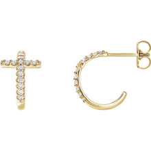 Treat the woman of faith to these dazzling diamond cross hoop earrings. Expertly crafted in 14k yellow gold, each hoop features a diamond-lined cross-shaped accent, a brilliant expression of her beliefs. Radiant with 1/4 ct. t.w. of diamonds and finished with a bright polished shine, these hoops secure comfortably with friction backs.