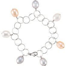 "Sterling silver clasp & wire wrapping. Perfect to wear everyday! Large irregularly shaped 10-11mm cultured pearls move with you. This wire wrapped white & pastel pearl bracelet is sure to impress. Overall length 7.25""."