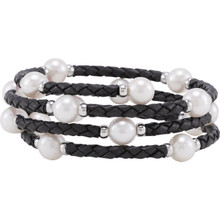 This pearl wrap bangle bracelet is crafted with genuine, black basket-weave style leather and features sixteen freshwater cultured white, round potato pearls, each bordered with polished .925 sterling silver beads.