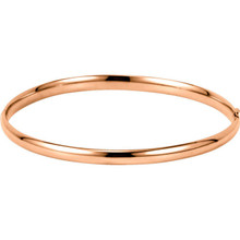 Crafted in brightly polished 14k rose gold, this hollow, hinged bracelet is lightweight yet looks substantial. A statement piece on its own, stack with other bracelets for an on-trend look.