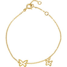 The minimalist design of this bracelet is perfect for drawing attention to the open butterfly shape in 14k yellow gold.