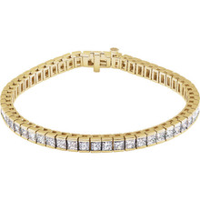 This fabulous 9 1/3 ct. t.w. diamond tennis bracelet is a breathtaking piece that we really love. Sparkling and sensational, it's a classic that features a stream of princess cut diamonds so gorgeous that it will have heads turning for a second look. 18kt yellow gold bracelet.