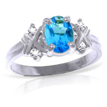 Original Ring size 6.0. A Natural Blue Topaz center stone is paired with two Genuine Diamonds on each side.