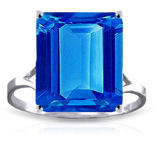 This very lovely 14k gold ring features a dazzling natural octagon blue topaz. The stone seems to flash with light and is held securely in place with a four-prong 14k gold setting. The precise octagon cut displays the vivid, deep blue color of the stone. The gemstone measures nearly one inch in height. The large stone, coupled with the gleaming gold setting, is sure to attract some attention during a night out on the town. The simple yet elegant ring setting comes in your choice of white, rose or yellow gold.