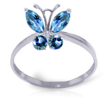 This 14k gold butterfly ring with natural blue topaz saccharine and beautiful. The gold setting can be changed to your choice of white, rose or yellow gold alongside your personal ring size. Four natural-blue topaz stones form the shape of a lovely butterfly. The stones are a total of 0.60 carats and make this ring the perfect size. It is never gaudy or overdone. This sweet ring is the perfect gift for a young girl or someone that loves butterflies. It will quickly become an everyday favorite, and earn a special place in her heart. Each ring is as unique as the natural stones used.