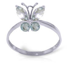 All girls will swoon when they see this fanciful ring. Light as a feather and fluttery free, a beautiful gemstone butterfly sits on the wearer's finger, waiting to be admired by all. This 14K gold Butterfly Ring with Natural Aquamarine is made with two round shaped .20 carat and two marquise shaped .40 carat Aquamarine gemstones. These beautiful faceted stones with a faint touch of color give this ring a real feminine appeal. This ring makes a great gift for a teenager or elegant young woman. Great for a sweet sixteen birthday or other special event. Catch this Aquamarine butterfly in all its glory.
