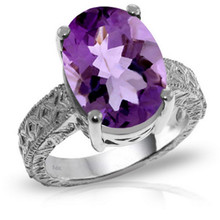 A 14 karat Gold Ring features a glistening Oval shape Natural Amethyst.