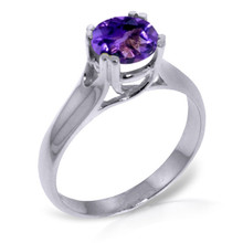 A 14k Gold Solitaire Ring features a bold looking Natural Amethyst.This showstopping ring makes a jaw dropping gift for those born in February.