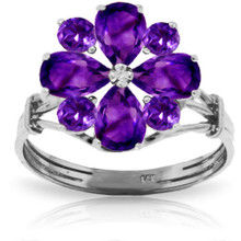 A faceted Amethyst stone is an absolute marvel to behold. It has a richness of color that is incomparable and a shimmer that can't be beat. In this 14K gold Ring with Natural Purple Amethysts, you will get Amethyst galore. This ring is made with four pear shaped 1.63 carat Amethysts and four round shaped 0.80 carat Amethysts. These glittery beauties are arranged to form a friendly flower design. These rich stones are set in a high quality 14K gold band. Wear this ring, and you can behold the marvel of this stone every single day of your life.