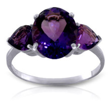 This 14k gold ring with natural amethyst makes a splendid birthday gift for those celebrating in February. This ring brilliantly displays the gorgeous February birthstone that has a classically beautiful look. One oval shaped center stone weighs an amazing three carats for extra sparkle to make her light up. Two radiant heart shaped amethyst stones flank either side of the center stone, adding another carat of beautiful bright purple. The simple white gold band pulls the piece together nicely to make it a classic favorite.