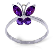 Poets describe them as FLOWERS THAT FLY and never has that description seemed more apart than when looking at this rich amethyst butterfly ring. The wings are set to catch the light and seem ready to take off at a moment's notice from the gold band. The deep purple of the marquise cut natural amethyst stones stands out against the gold setting, whether you choose white gold, yellow gold, or rose gold. So are you looking at a butterfly or a violet poised for flight? Make it your ring and you can decide.