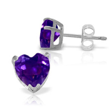 Dainty heart jewelry is the perfect way to show that special someone how much they are adored. With these 14k white gold stud earrings with natural amethysts, beautiful color, sparkling gemstones, and a feminine shape is combined to create a stunning pair of earrings. Two heart shaped purple amethysts gems glimmer brightly from the earlobes, boasting over three carats of pure beauty. The 14k yellow gold prongs and posts, secured with friction push backs, makes these earrings look classic while they are held securely in place in each earlobe. These earrings make a great gift for those who celebrate a birthday in February.
