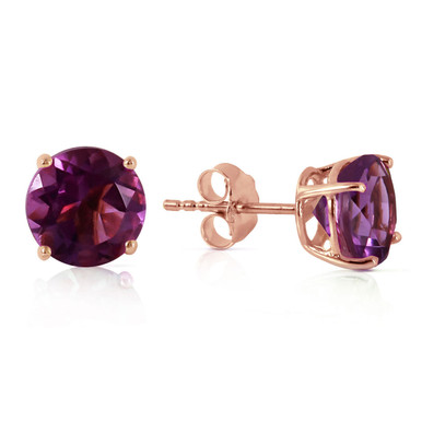Solitaire studs are one of the most popular styles of earrings that are a simple way to look stylish and beautiful. These 14k rose gold stud earrings with natural amethyst are easy to wear and appropriate to wear at any time. With a 3.10 carat combined weight, these stunning gems are large enough to attract attention without being overwhelming. The bold purple color of these stones also help them to stand out as a stunning pair of earrings that are perfect for any occasion.