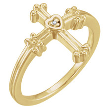 Crafted in 14k yellow gold this ring features a diamond solitaire set in a heart and ornate cross setting.