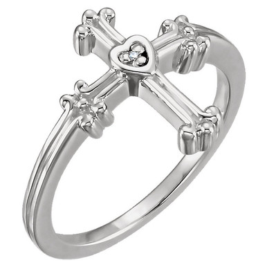 Crafted in 14k white gold this ring features a diamond solitaire set in a heart and ornate cross setting.