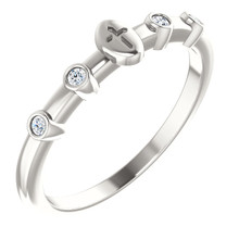 Stackable Expressions is a simple and stylish assortment of rings that can be worn together to express your style, your family and your personality. This exquisite ring is a beautiful expression of your faith. Fashioned in fine platinum, this ring is topped with a traditional cross set with .06 ct. t.w. of shimmering diamonds. Polished to a brilliant shine, this ring adds a meaningful touch to your personal stack.