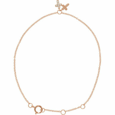 """This dainty 5-7"""" adjustable bracelet, encrusted with glittering diamonds, offers a sparkling symbol of faith. Polished to a brilliant shine."""