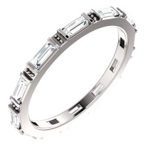 Classic and timeless, this diamond eternity ring features a continual band of baguette diamonds all set in enduring 14k white gold.