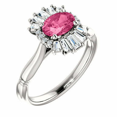 Crafted in sterling silver, this ring features one oval Genuine Pink Tourmaline gemstone accented with 18 genuine diamonds.