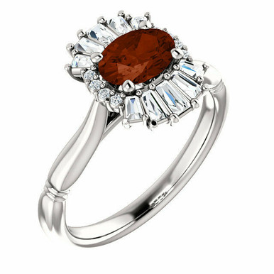 Crafted in 14k white gold, this ring features one oval Genuine Mozambique Garnet gemstone accented with 18 genuine diamonds.