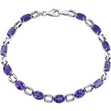 Simply spectacular, this stunning fine bracelet will win the February-born birthday girl's heart! Fashioned in 14K White Gold, this eye-catching bracelet is lined with glistening 07.00x05.00mm amethyst stone - a colorful take on tradition. Polished to a brilliant shine, this is a 7.15 inch bracelet.