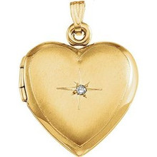 Win her heart with this dazzling diamond heart locket in 14k yellow gold.