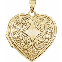 This timeless piece of jewelry is crafted with polished 14k yellow gold. Design-Engraved Heart Locket.