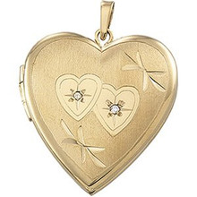 Perfect for any occasion especially for a young lady. Diamond heart locket in 14k yellow gold.
