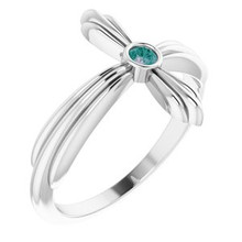 A lovely expression of faith, this gemstone ring proclaims deep and heartfelt devotion.