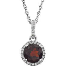 "Garnet and Diamond 14k White Gold Halo-Styled 18"" inch Birthstone Pendant Necklace. A 7.0mm Genuine Round Garnet is surrounded by 1/10 ct.tw. of Sparkling Genuine Round Diamonds."