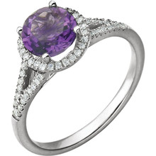 Beautiful Halo-style Gemstone Ring in 14K White Gold featuring a Natural Amethyst Gemstone & Diamonds. The ring consist of 1 Round Shape, 7.0 mm, Amethyst Gemstone with 56 Accent genuine Diamonds. This ring is both Elegant and Classic - Perfect for everyday. The inherent beauty of these gems make this an ideal way for you to show your love to someone you care for.