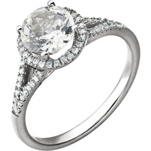 Beautiful Halo-style Gemstone Ring in 14K White Gold featuring a created white sapphire ring Gemstone & Diamonds. The ring consist of 1 Round Shape, 7.0 mm, Created White Sapphire Gemstone with 56 Accent genuine Diamonds. This ring is both Elegant and Classic - Perfect for everyday. The inherent beauty of these gems make this an ideal way for you to show your love to someone you care for.