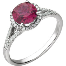Beautiful Halo-style Gemstone Ring in 14K White Gold featuring a created ruby ring Gemstone & Diamonds. The ring consist of 1 Round Shape, 7.0 mm, Created Ruby Gemstone with 56 Accent genuine Diamonds. This ring is both Elegant and Classic - Perfect for everyday. The inherent beauty of these gems make this an ideal way for you to show your love to someone you care for.