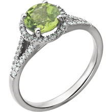 Beautiful Halo-style Gemstone Ring in 14K White Gold featuring a peridot ring Gemstone & Diamonds. The ring consist of 1 Round Shape, 7.0 mm, Peridot Gemstone with 56 Accent genuine Diamonds. This ring is both Elegant and Classic - Perfect for everyday. The inherent beauty of these gems make this an ideal way for you to show your love to someone you care for.