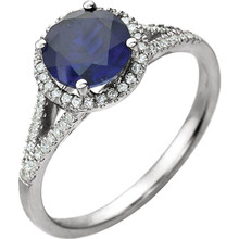 Beautiful Halo-style Gemstone Ring in 14K White Gold featuring a created blue sapphire ring Gemstone & Diamonds. The ring consist of 1 Round Shape, 7.0 mm, Created Blue Sapphire Gemstone with 56 Accent genuine Diamonds. This ring is both Elegant and Classic - Perfect for everyday. The inherent beauty of these gems make this an ideal way for you to show your love to someone you care for.