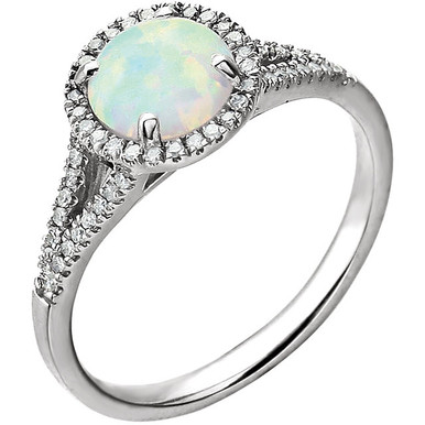 Beautiful Halo-style Gemstone Ring in 14K Solid White Gold featuring a created opal ring Gemstone & Diamonds. The ring consist of 1 Round Shape, 7.0 mm, Created Opal Gemstone with 56 Accent genuine Diamonds.  This ring is both Elegant and Classic - Perfect for everyday. The inherent beauty of these gems make this an ideal way for you to show your love to someone you care for.