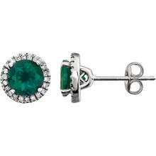 A beautiful crafted 14k white gold 1/8 ct. tw. diamond & 6mm emerald friction post stud May birthstone earrings. Emerald is the birthstone for May representing the symbol of rebirth and is believed to grant good luck and youth. Emerald is derived from the word smaragdus, meaning green in Greek and was mined in Egypt as early as 330 B.C. Most of the world's emeralds are mined in Colombia, Brazil, Afghanistan, and Zambia today.