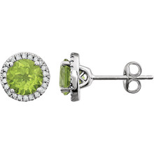 A beautiful crafted 14k white 1/8 ct tw diamond & 6mm peridot friction post stud August birthstone earrings. Peridot is the birthstone of August and is believed to have healing properties to protect against nightmares and help acquire power, influence, and success.