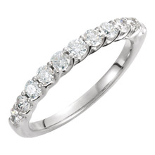Honor your vows as you slip this enchanting 14K white gold diamond wedding band on her finger, creating a moment the two of you will always treasure. From that special day forward, this ring will serve as a memory of that day and of your promise to love each other forever. Set with shimmering round diamonds totaling 5/8 ct., it's a thoughtful, polished look she'll adore.