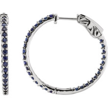 Designed with the September-born birthday girl in mind, these glam and glistening hoops are perfect for her vivacious personality. Fashioned in 14K White Gold, these hoops feature an array of shimmering bright blue sapphires set along the inside and outside edges. Brilliant from every angle, these polished hoops secure comfortably with hinged backs.