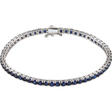 Dress her wrist in glittering style. Fashioned in 14K white gold, this exquisite bracelet pairs 3.0mm round-shaped blue sapphires, the traditional birthstone for September. The bracelet measures 7.25 inches in length.