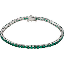 Dress her wrist in glittering style. Fashioned in 14K white gold, this exquisite bracelet pairs 3.0mm round-shaped created emeralds. In May, wish her a very special happy birthday with the gift of jewelry featuring her birthstone, emerald. The bracelet measures 7.25 inches in length.