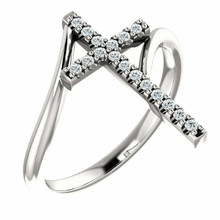 Share your faith for all to see with this sparkling diamond cross ring. Certain to become a treasured favorite, this ring captivates with 1/8 ct. t.w. of diamonds and a polished shine. Diamonds are G-H in color and I1 or better in clarity.