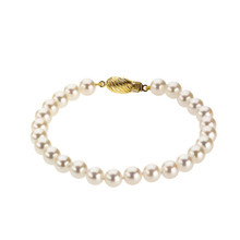 Akoya Cultured Pearl bracelet fashioned in 14K yellow gold. Bracelet measures 06.00-06.50mm and polished to shine.     Quality: 14K Yellow Gold  Style: Bracelet  Size: 6.00-6.50mm  Length: 7.00 Inches  Finish State: Polished  Pearl Quality: A  Country of origin for pearl is: Japan