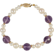 Freshwater Cultured Pearl & Amethyst Bracelet fashioned in 14K yellow. Bracelet stones measures 5.00-10.00mm and polished to shine.