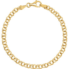 Classic, solid 14K yellow gold charm bracelet is seven inches in length and is approximately 1/8th inch wide.  The bracelet is made in the double curb style.  It is connected with a sturdy lobster claw clasp.